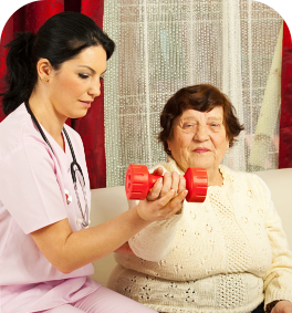 old woman having a physical therapy assisted by her caregiver